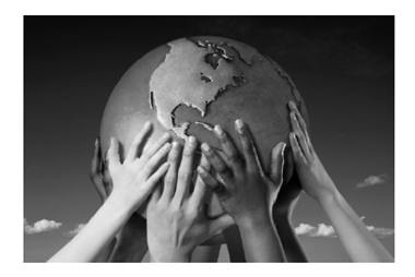 photo of hands holding up a model of the world