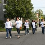 A group of participants, volunteers and staff head out to talk to our neighbours