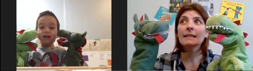 preschool program worker Sonia is on zoom with a young boy. they're both playing with the same dinosaur puppets