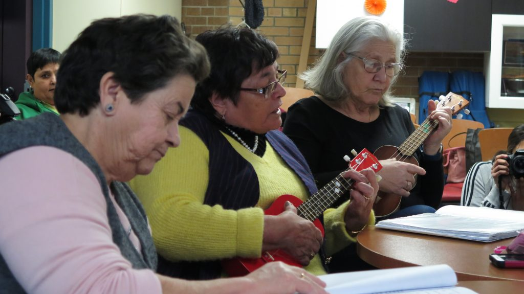 Older adults participate in an activity at the West Active Living and Learning Centre